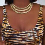 woman Miami gold cuban link